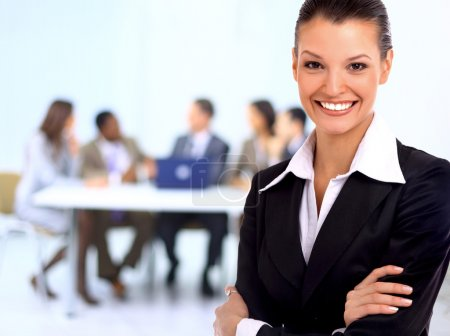 Foto de Portrait of successful businesswoman and business team at office meeting - Imagen libre de derechos