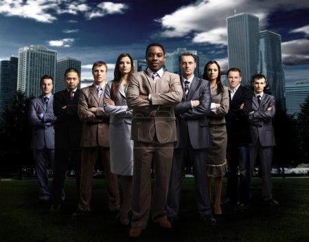 International business team over modern urban background