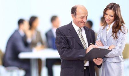 Photo pour Image de trois entreprises travaillant à la réunion - image libre de droit