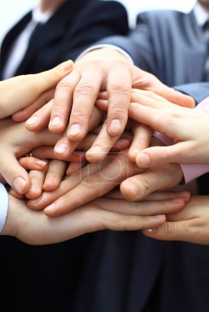 Hands piled on top of one another.