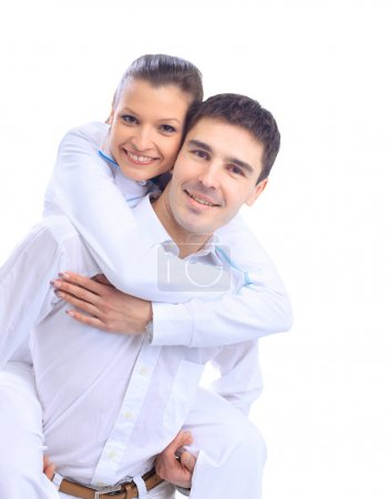 Portrait of a happy young couple having fun together against white backgrou
