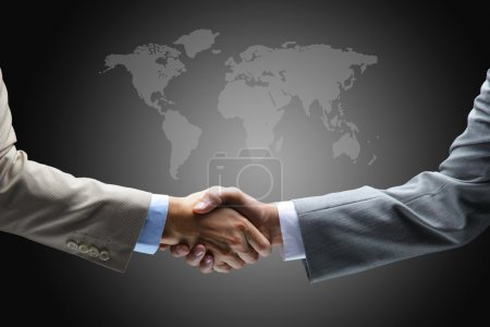 Photo for Handshake with map of the world in background - Royalty Free Image