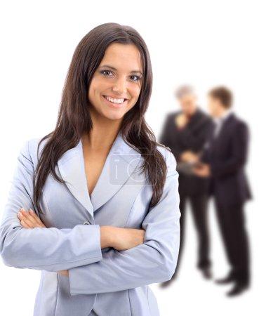 Photo pour Une jeune femme d'affaires séduisante et son équipe - image libre de droit