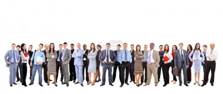 Business team formed of young businessmen and businesswomen standing over a