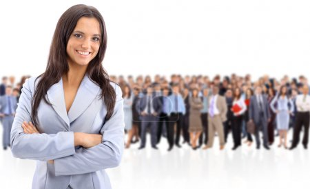 Photo for Happy young business woman standing in front of her team - Royalty Free Image