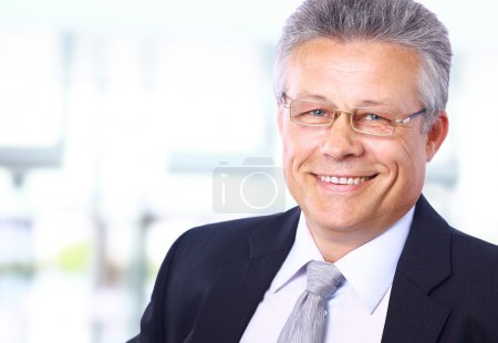 Photo for Portrait of a happy senior business man smiling - Royalty Free Image