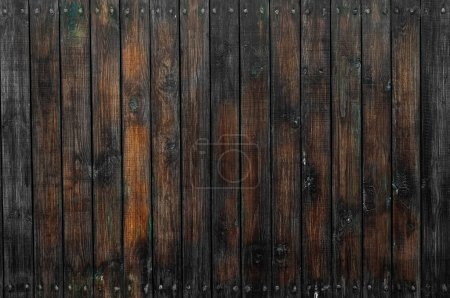 Photo for A dark wooden wall as a background - Royalty Free Image