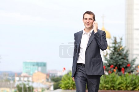 Young man with mobile phone outdoors