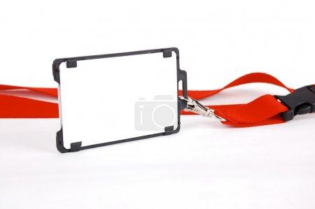 Photo pour Un insigne avec un ruban rouge sur fond blanc - image libre de droit