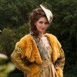The young woman in clothes of 18 centuries outdoor...