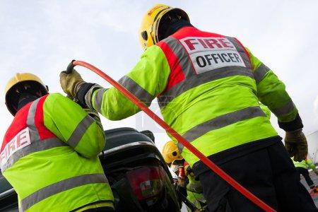 Fireman with Power Wedge at car crash
