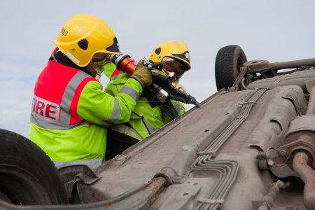 Firemen with Power Wedge at car crash