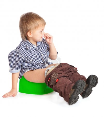 Photo for A boy sitting on the pot. Isolated on a white background - Royalty Free Image