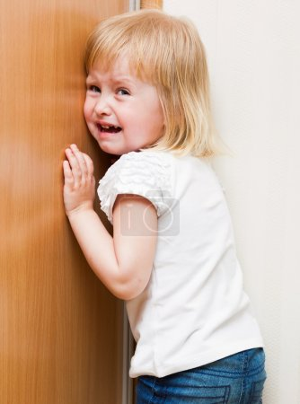 Photo for Naughty little girl is standing in the corner - Royalty Free Image
