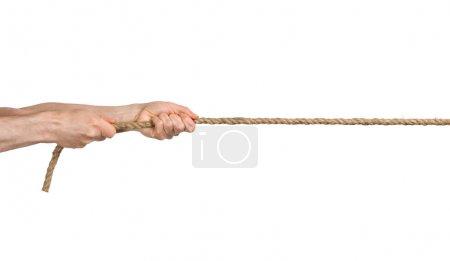 Photo pour Les mains tirent une corde. Fond blanc isolé - image libre de droit