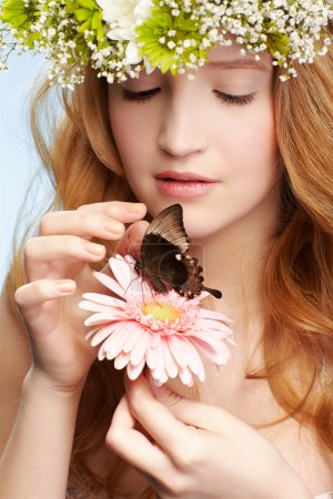 Beautiful girl and butterfly