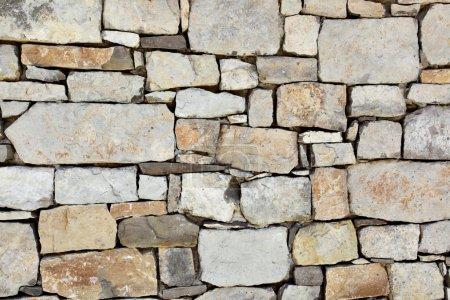Photo pour Mur en pierre, peut être utilisé comme fond - image libre de droit