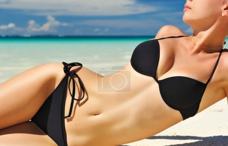 Photo for Woman with beautiful body on a tropical beach - Royalty Free Image