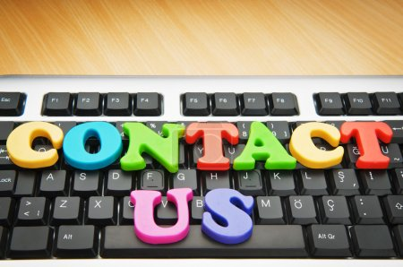 Photo for Contact us concept with letters on keyboard - Royalty Free Image