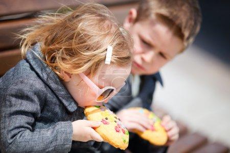 Kids eating cookie