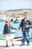 Kids in city near harbor