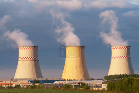 Power plant cooling towers against blue sky