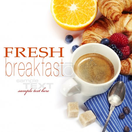 Photo for Delicious breakfast with fresh coffee, fresh croissants and fruits (with sample text) - Royalty Free Image