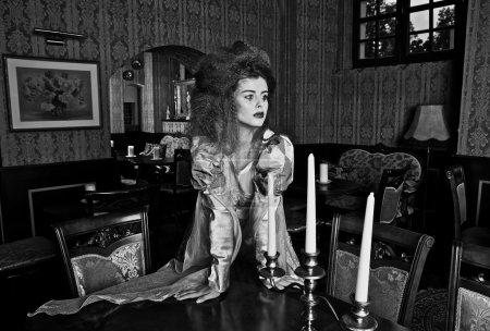 Gloomy duchess. Vogue style vintage portrait in luxury interior.