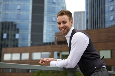 Photo for Portrait of a handsome smiling young business man. Outdoor photo. - Royalty Free Image