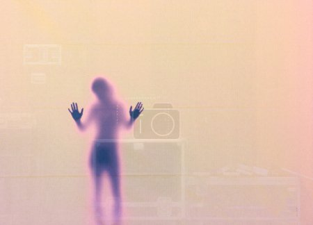Photo for Woman Silouette with her Hands at the Wall, Sweden - Royalty Free Image