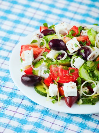 Photo for Fresh greek salad with feta, tomato, cucumber and olives - Royalty Free Image