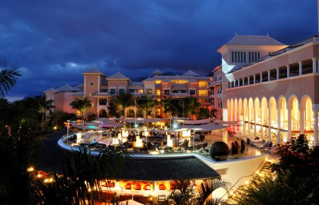 Night illumination of luxury hotel and clouds, Tenerife island,