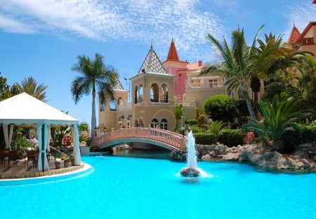 Swimming pool with fountain at luxury hotel, Tenerife island, Sp