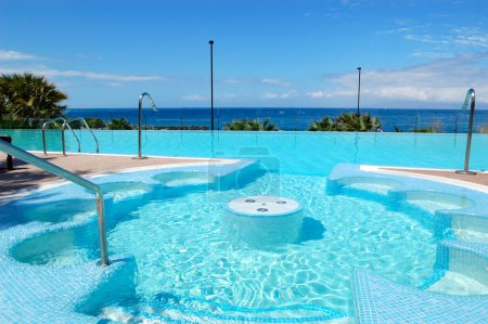 Swimming pool with jacuzzi at luxury hotel, Tenerife island, Spa