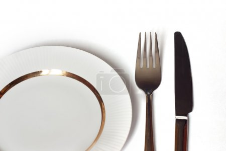 Photo for Knife and fork and white plate - Royalty Free Image