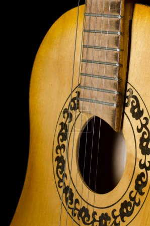 Photo for The acoustic guitar on a black background - Royalty Free Image