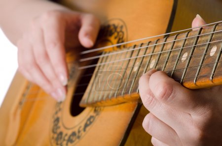 Photo for The woman plays an acoustic guitar close-up - Royalty Free Image