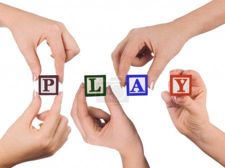 Photo pour Main et jeux de mots isolés sur fond blanc - image libre de droit