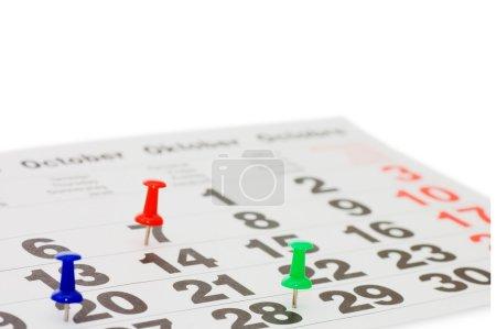Calendar and Thumbtack close up shot