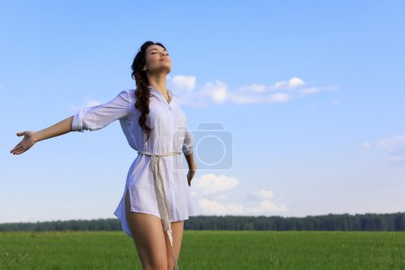Photo for Young happy woman in green field - Royalty Free Image