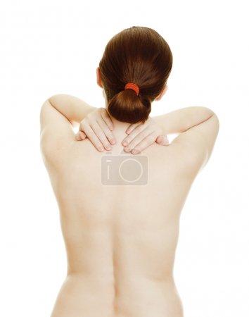 Osteochondrosis - woman massaging pain back
