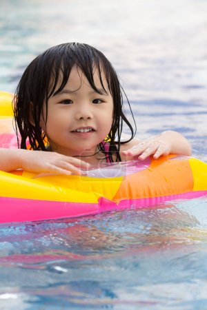 Photo for Little girl is having fun in swimming pool - Royalty Free Image