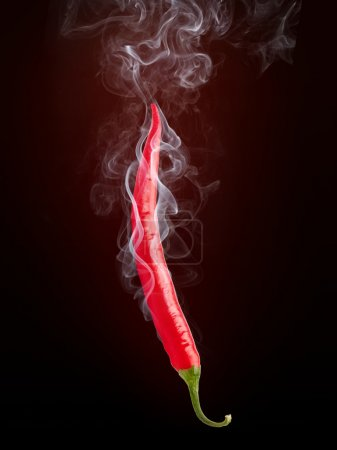 Photo for Hot Pepper in Smoke Isolated on Black Background. - Royalty Free Image