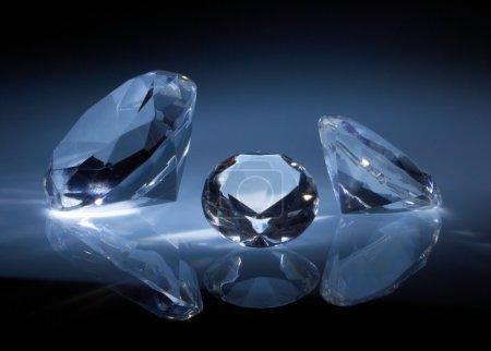 Shiny diamonds jewel on dark blue