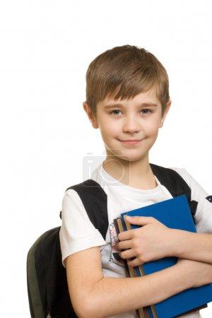 Photo pour Garçon de 10 ans avec un sac à dos isolé sur fond blanc - image libre de droit