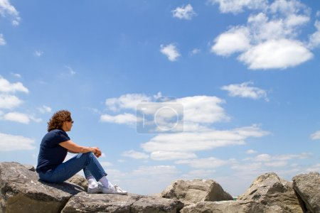 Woman Watching From Rocks