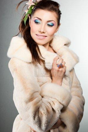 Elegant fashionable woman in a fur coat