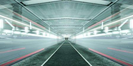 Illuminated modern metro station with train motion