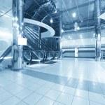 Business hall with escalators...
