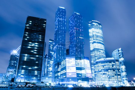 Photo for Perspective view to glass high-rise skyscrapers of Moscow city business center at night - Royalty Free Image